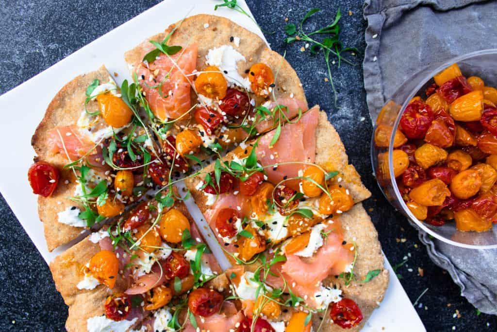Rye Flatbread with Slow Roasted Tomatoes, Creamcheese, Salmon, Microgreens & Everything Bagel Seasoning