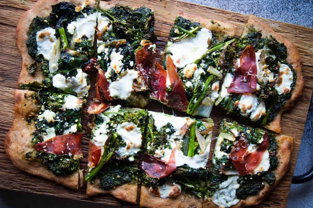Early Spring Kale Pesto, Prosciutto, & Mozzarella Pizza