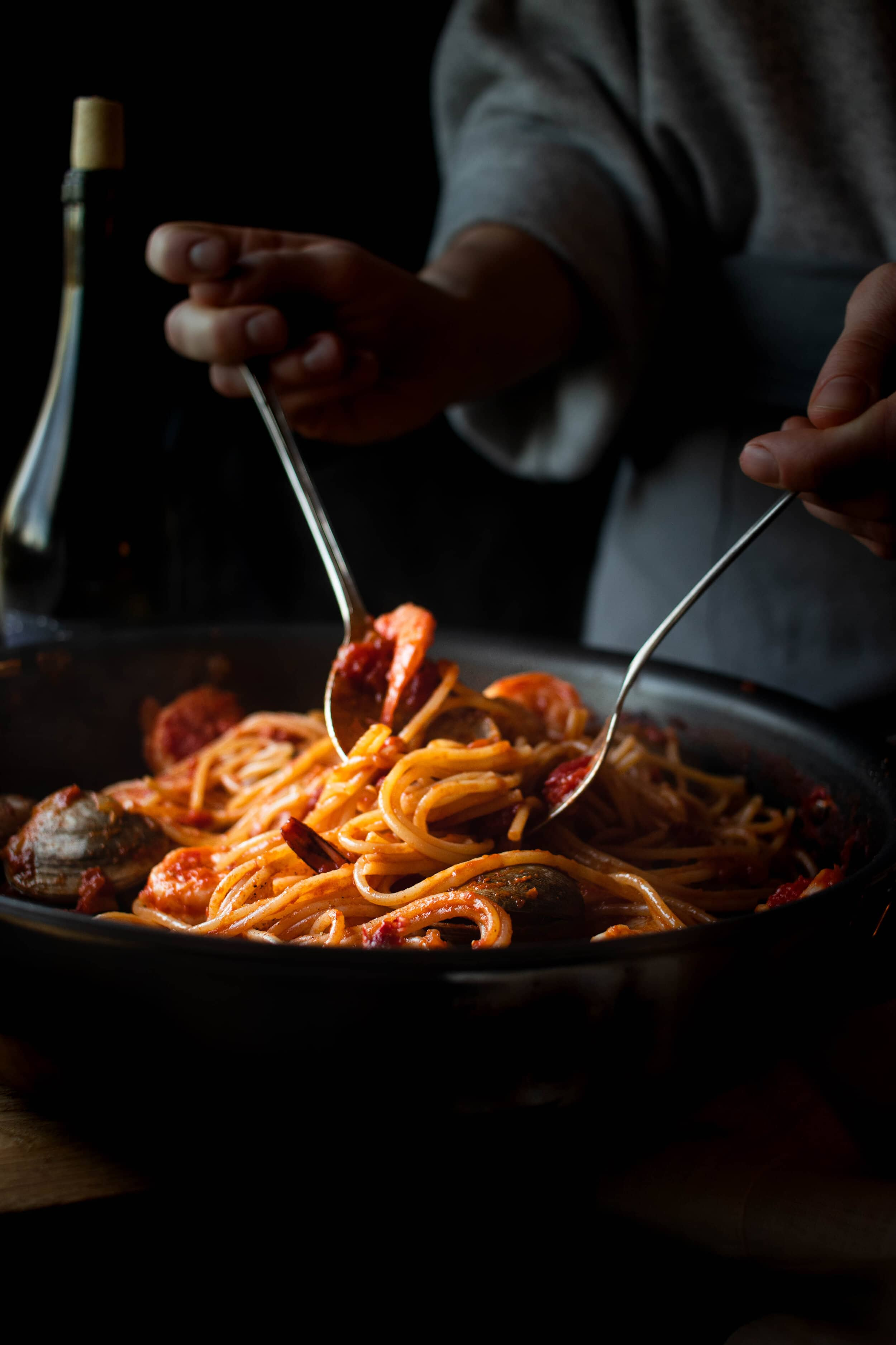 tomato seafood pasta with hands edited-2.jpg